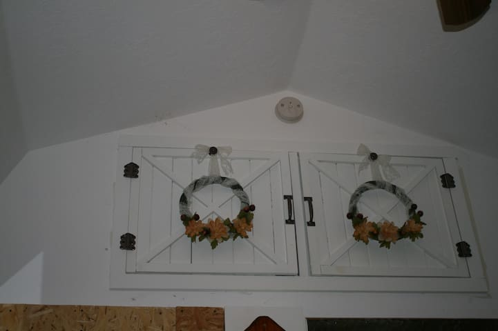 The storage compartment above the kitchen, directly across from the sleeping loft.  Attractively decorated, well-appointed, featuring all safety equipment.