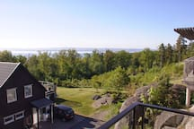 A morning view in May , crispy green colors and in the horizon cities of Huskvarna and Jönköping in sight.