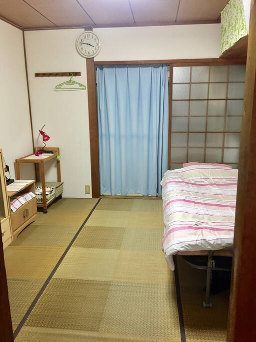 Bedroom downstairs with a single bed, TV and a DVD player  Another set of futon can be spread next to the bed