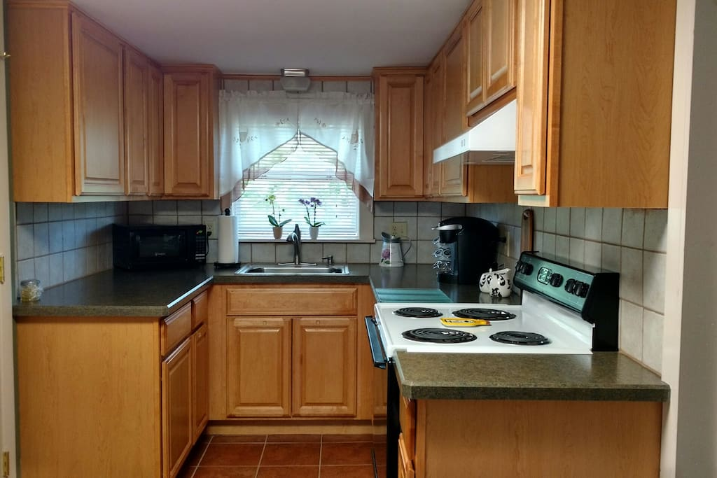 Newly renovated kitchen, ceramic tile flooring