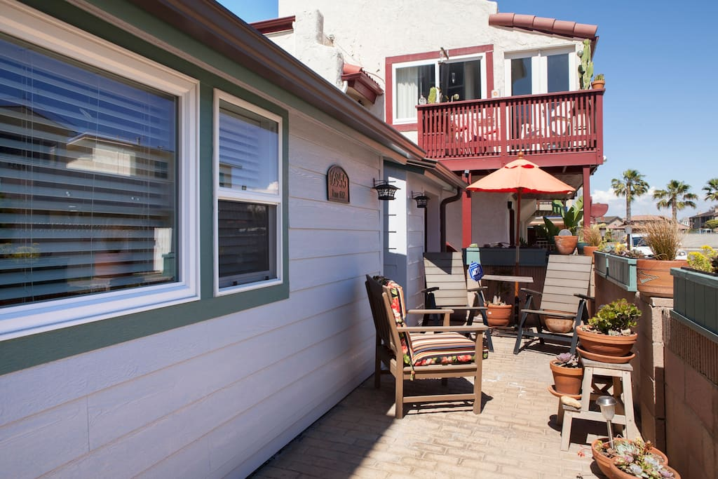 Enjoy a glass of wine on the spacious front porch with views to the beach!