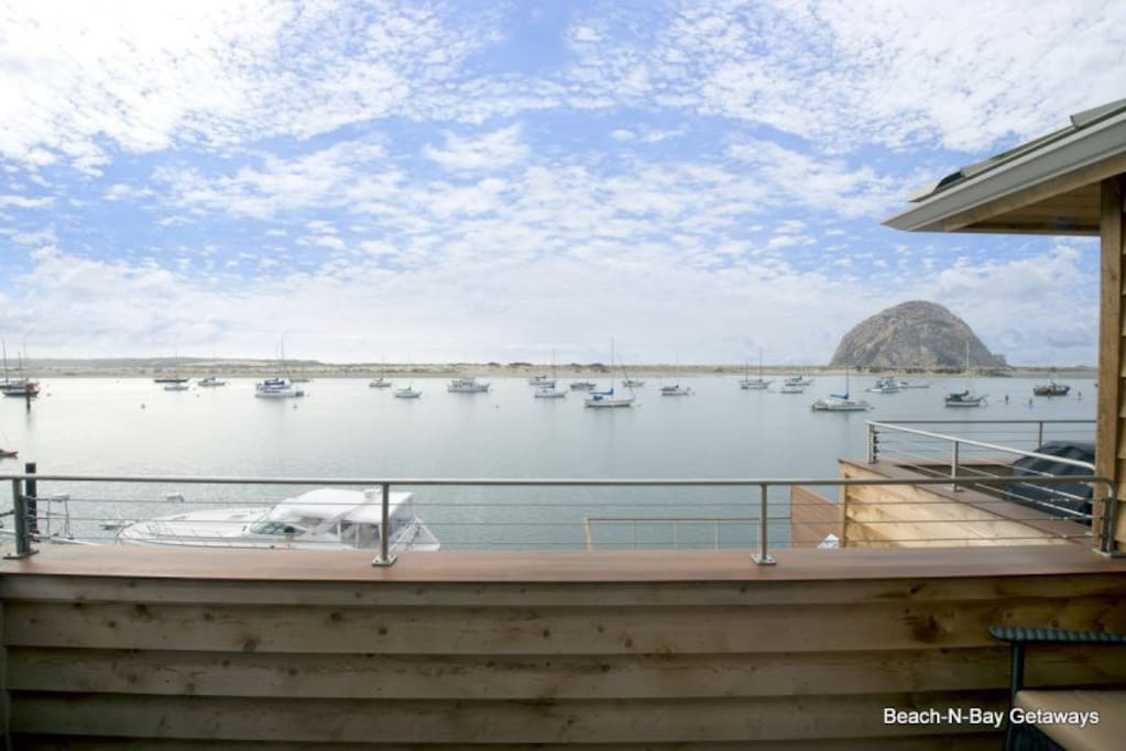 From the balcony you get amazing views of the bay and ocean and rock.  The balcony has a Weber barbeque grill and comfortable rocking chairs.