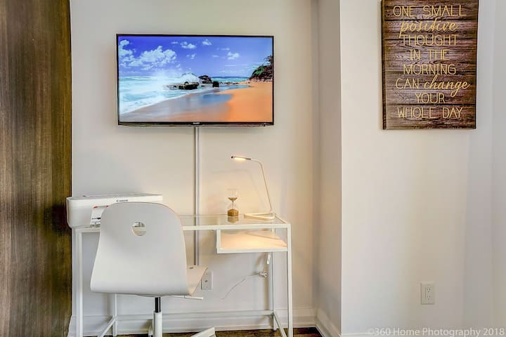 "Desk space along a functioning printer. 42"" Smart TV"
