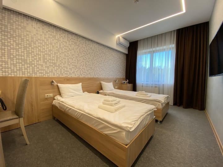 Двухместный номер с раздельными кроватями и душем