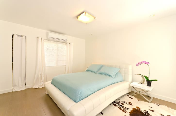 Nice large bedroom with queen comfy bed & linen closest. A/C and Heater over the window curtains