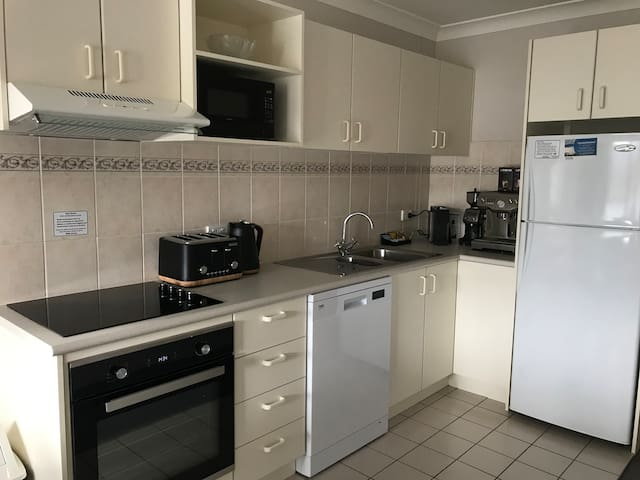 Open plan fully equipped kitchen with brand new oven, stove, microwave, Breville coffee machine & grinder plus ALDI capsule machine for a quick cup, toaster for 4. New fry pans, wine glasses, glad wrap & alfoil, paper towels,salt & pepper, olive oil