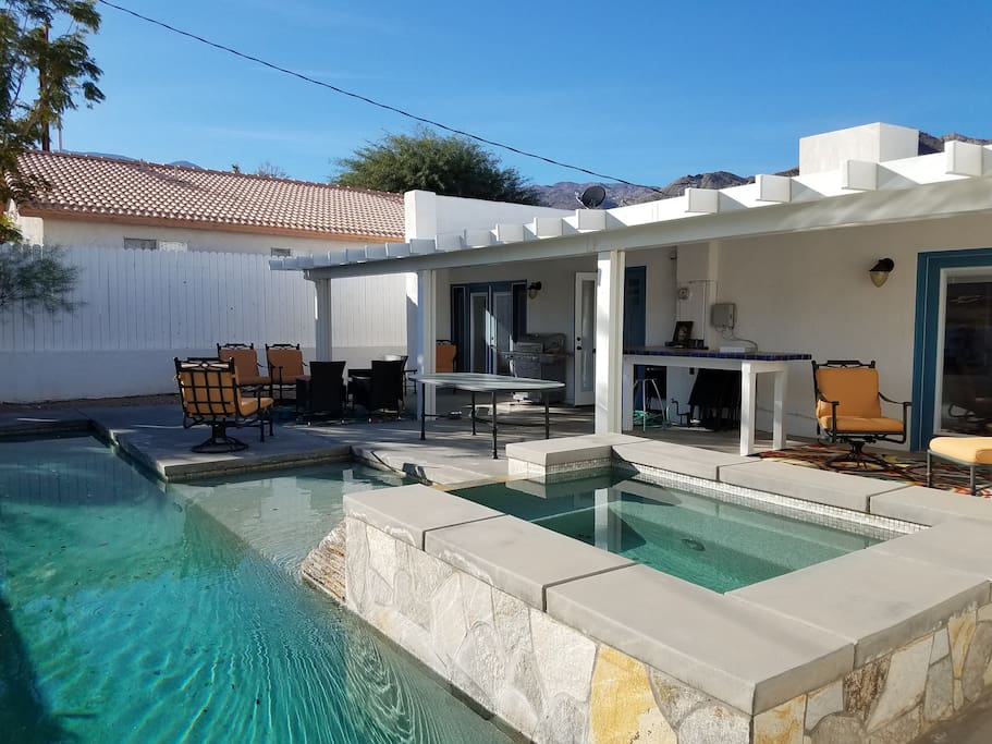This house is all about indoor/outdoor living. The entire back is open to the pool area