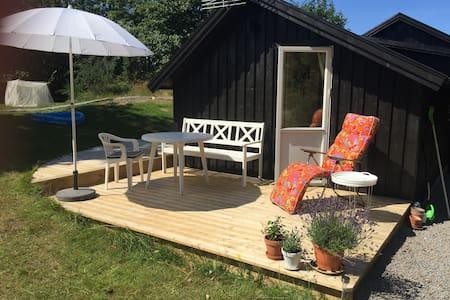 Grön sommarstugepärla - Falkenberg S