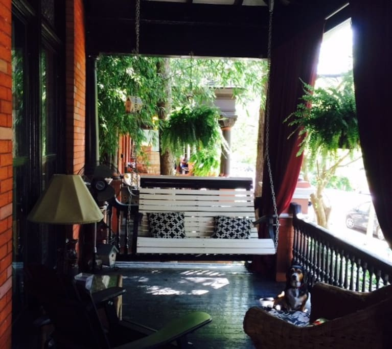 Front porch with a lovely swing - you will often find us out here in nice weather