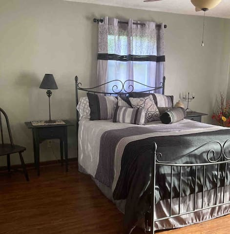 This bedroom has French doors leading to the hot tub deck and it has a queen mattress