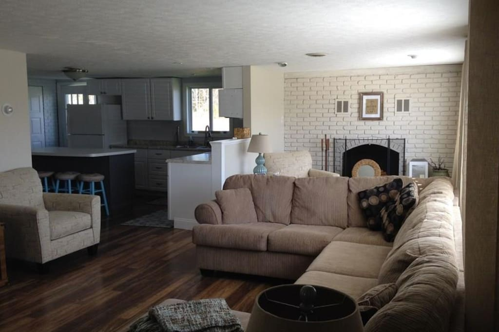 Plenty of seating, fireplace and game table