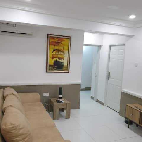 Adorable 1 bedroom and sitting room in a quiet zone  with a car for movement around abuja
