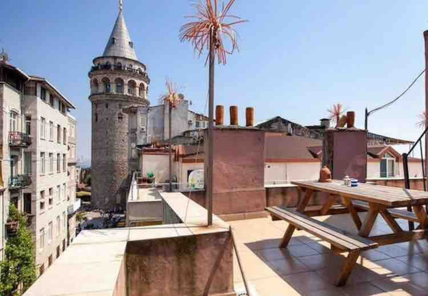 the use of a large terrace which is very close to the galata tower.
