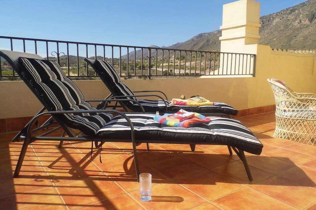 West terrace with sunbeds