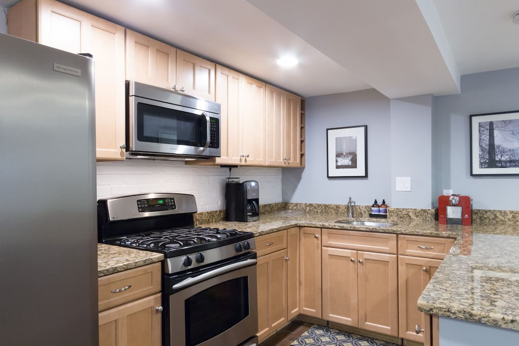 Brand new kitchen with granite countertops and stainless appliances!