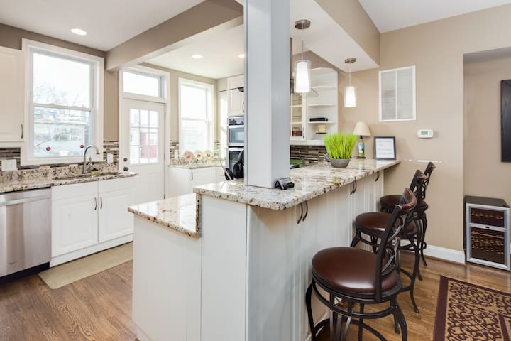 Bar-stool height counter-top into kitchen - with three nice barstools!