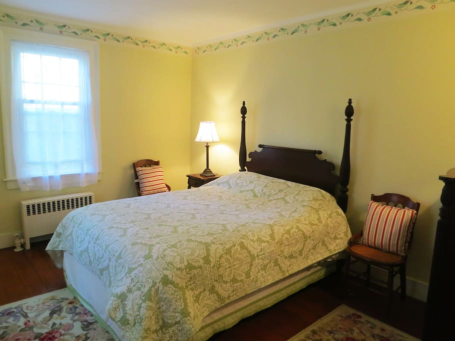 The Queen Anne room has hand-stenciled trim and an antique bed frame with new queen-sized mattress.