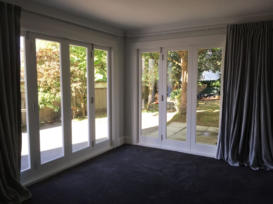 Doors that open out to the garden from the bedroom/ lounge area
