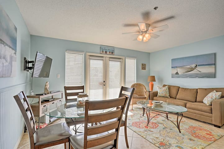 Take a seat and browse for a movie on the flat-screen cable TV in the living room.