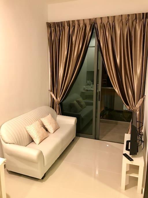 Cozy Living Room with Balcony & TV
