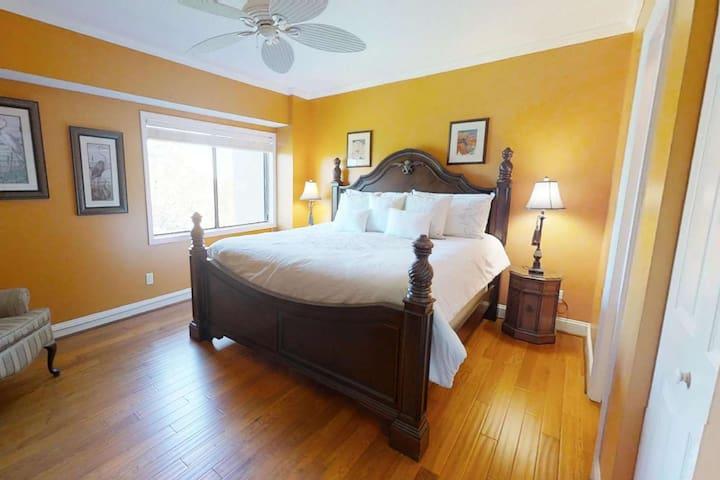 Master bedroom, located on the second level, with king size bed, ceiling fan and plenty of light