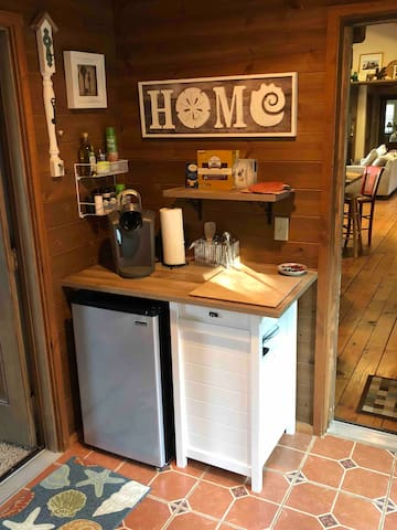 Kitchenette in sunny entryway has butcher block prep table with mini -fridge below, electric skillet, Breville toaster oven  & all basic cookware needed plus  seasonings, oils & thoughtful touches.