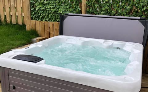 A stunning newly built house with a hot tub!