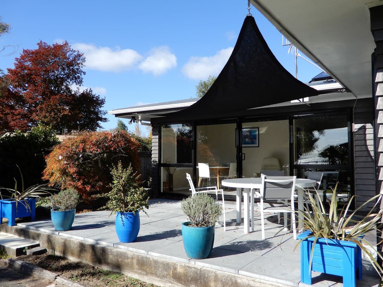 Enjoy a morning coffee on the deck under the sail with views to Lake Rotorua. BBQ for easy cooking.