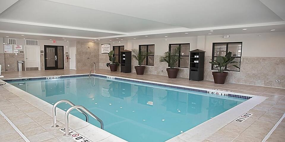 Free Wi-Fi, Free Breakfast + Indoor Pool | Suite with Roll-in Shower Near Sea Life Michigan