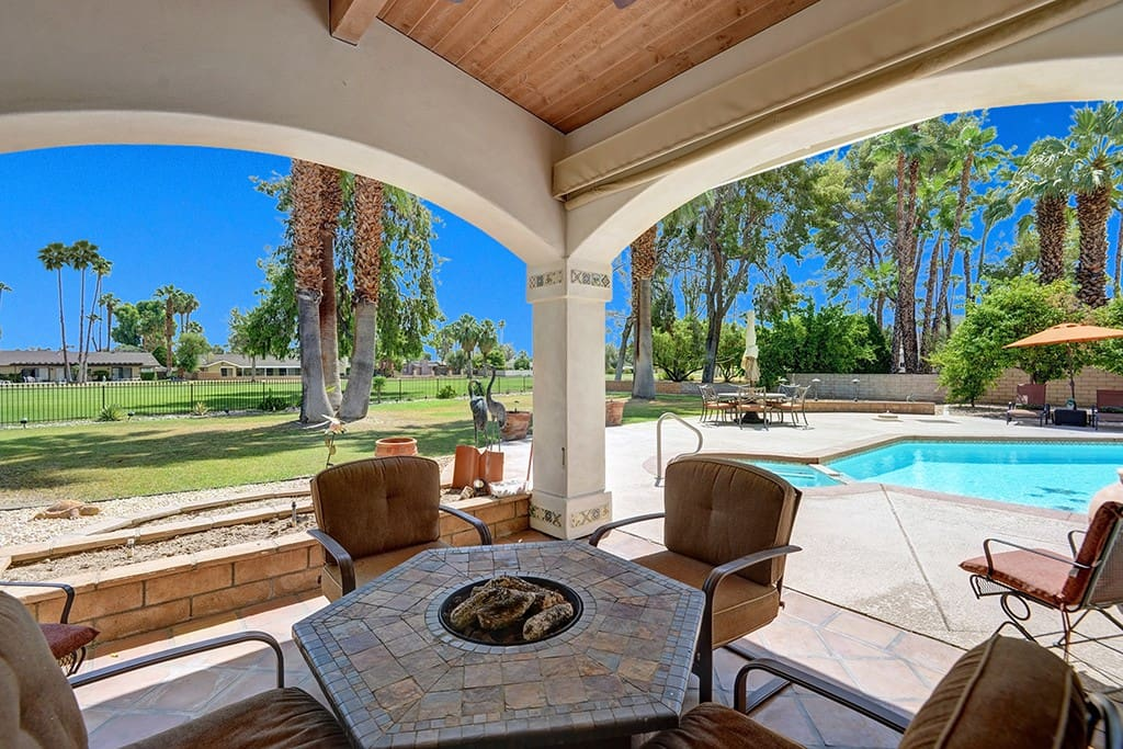 Chill by the Fire Pit  - Oranj Palm Vacation Homes