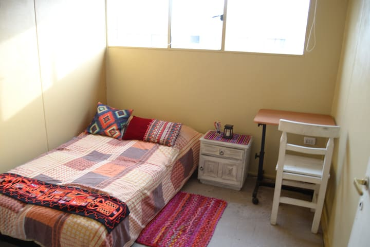 Room in traditional population of Santiago