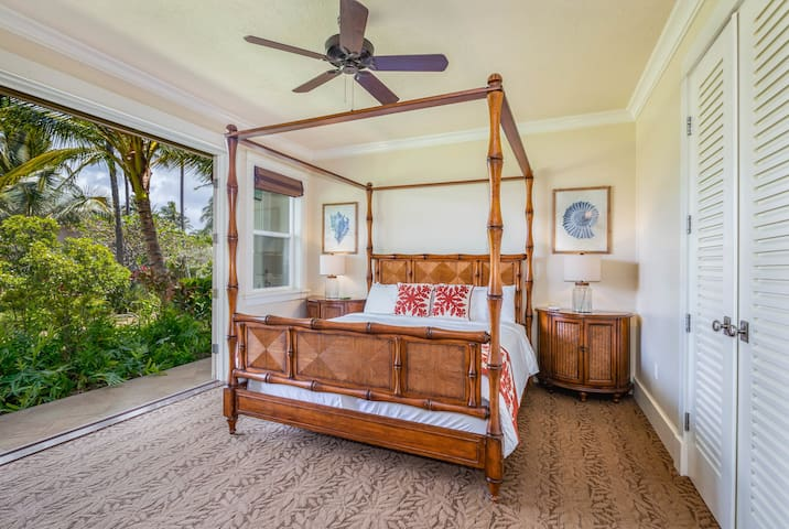 Master Bedroom 1. Relax in the king sized bed with doors that open to the lanai and greenbelt.