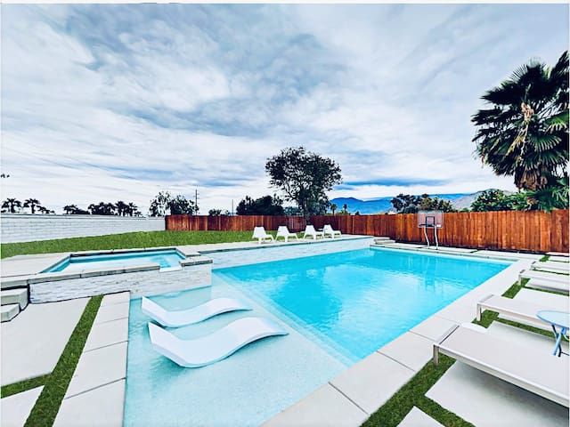 19'x38' size of big private oasis with basketball hoop, tanning deck with in-water chairs/umbrella, and spa surrounded by gorgeous mountain view