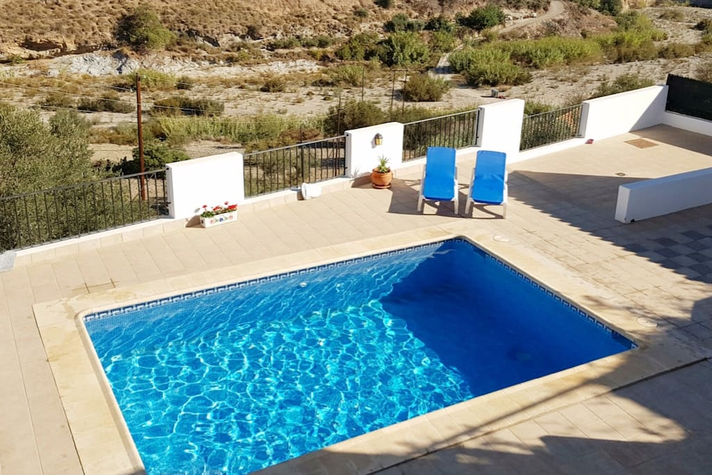 Aerial View of Heated Swimming Pool on large terrace overlooking beautiful rural Andalucian countryside