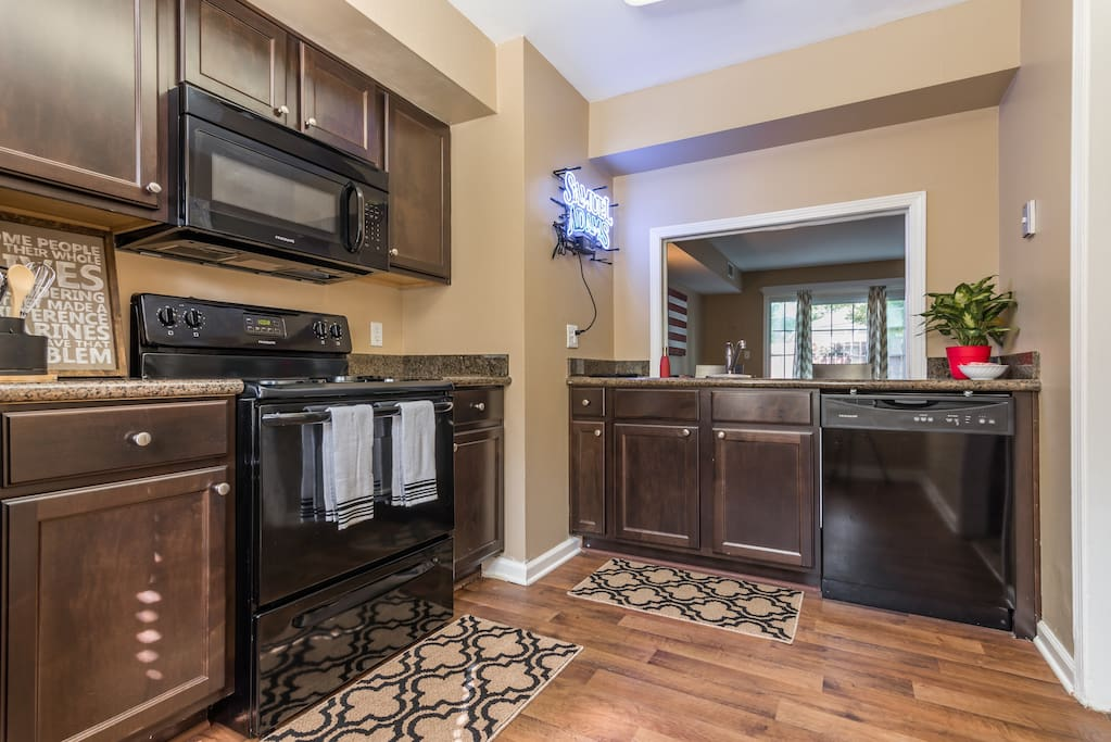 Comfortable kitchen with the essentials and handsome stained cabinets!