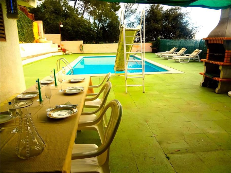 Patio dining with view of the pool and water slide