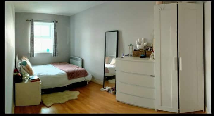 Cozy bedroom in modern clean apartment