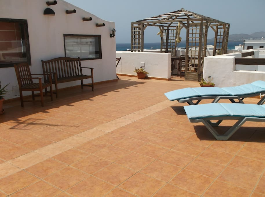 Roof top lounge leading out to the roof terrace with beautiful sea views