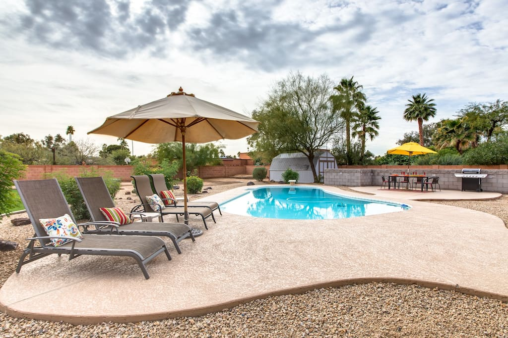 Relax poolside with shade tree's and Umbrella's in a huge peaceful, relaxing garden with sun loungers and umbrella's
