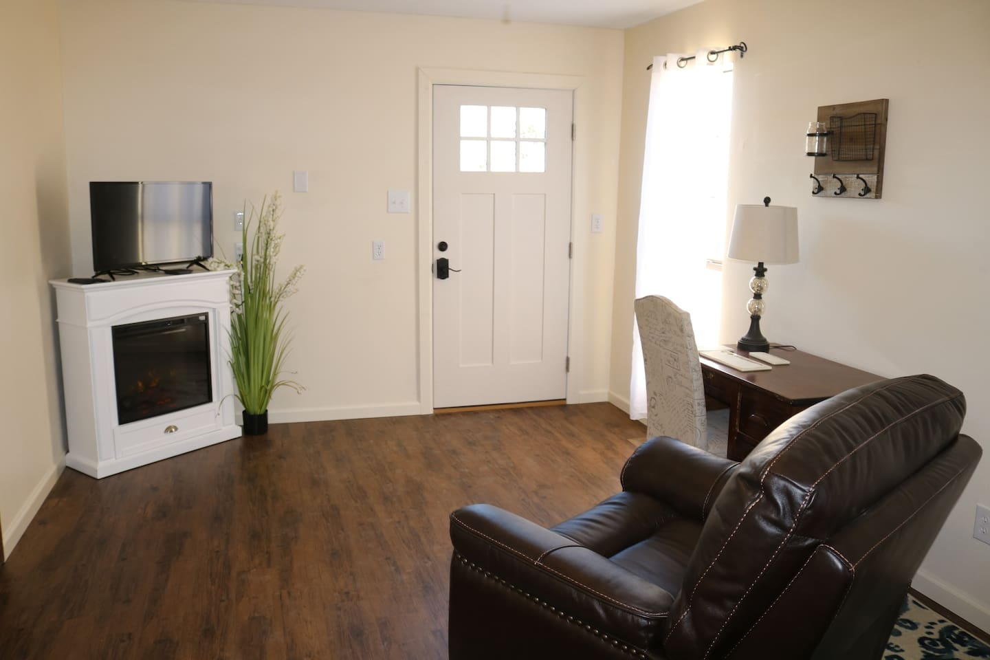 Main area has a electric fireplace, cable television, work desk, oversize recliner.