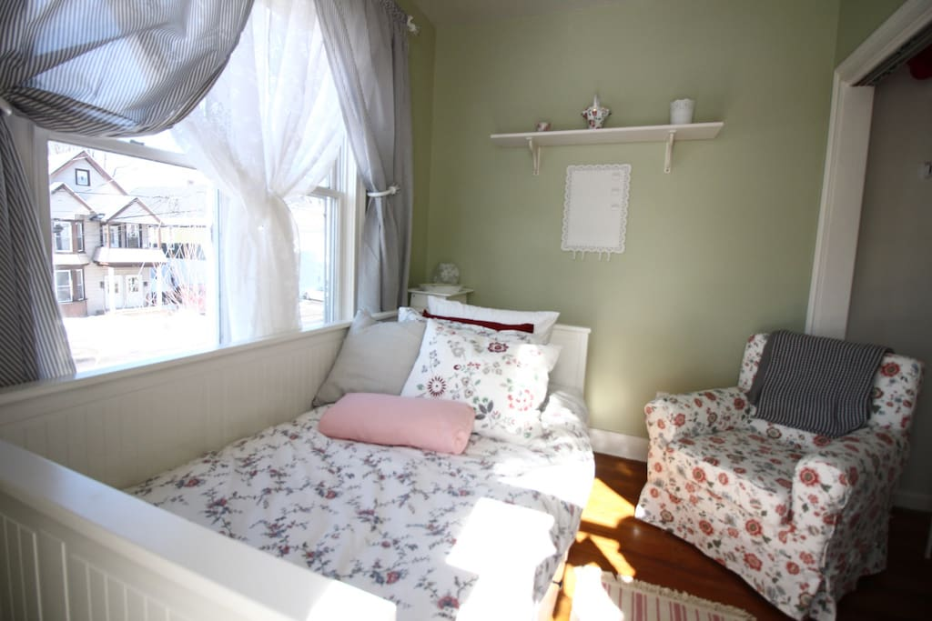 Room is located at the front of the house with large windows to let in lots of light. Comfy chair to relax in.
