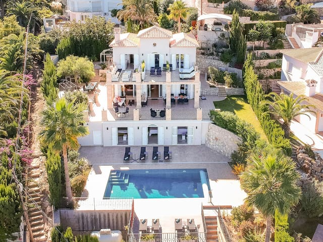 A luxury boutique hotel style villa with Med views