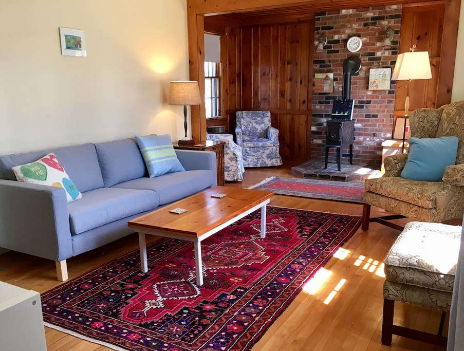 Spacious front living room with a small siting area off to the left with 2 sweet chairs and a tiny wood stove. This room also has a brand new 40 in smart TV and excellent internet.