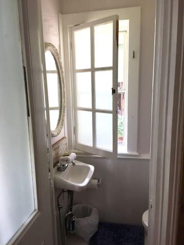 Adorable bathroom off of the bedroom