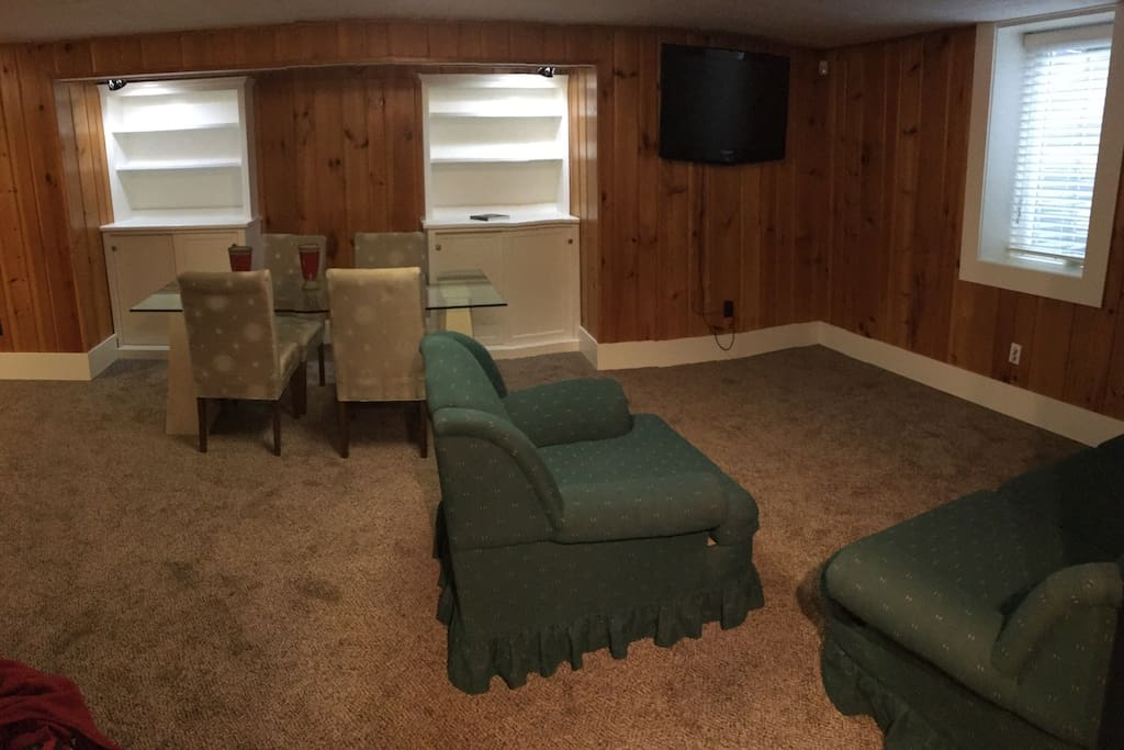 Large family room with formal dining table.  There is lots of space outside of the bedroom for additional sleeping areas or just relaxing
