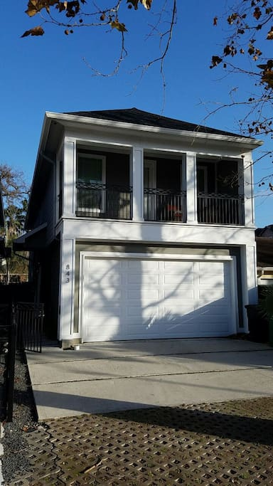 Standalone 2-story townhouse with 2 car garage and private driveway parking for up to 4 additional vehicles.
