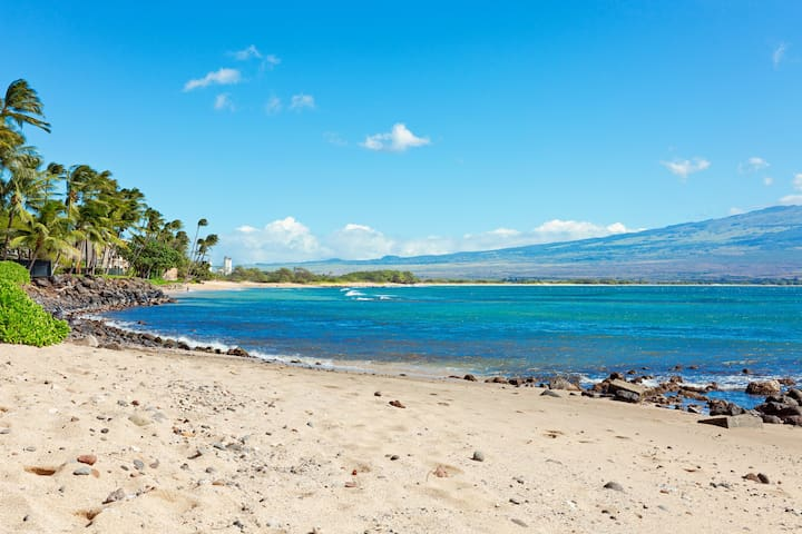 Little, rarely used beach located just steps from our lanai. Frequented by sea turtles, this is the perfect place to bring your beach chairs (provided by us) and take in the amazing views. Beautiful Sugar Beach can be seen in the background.
