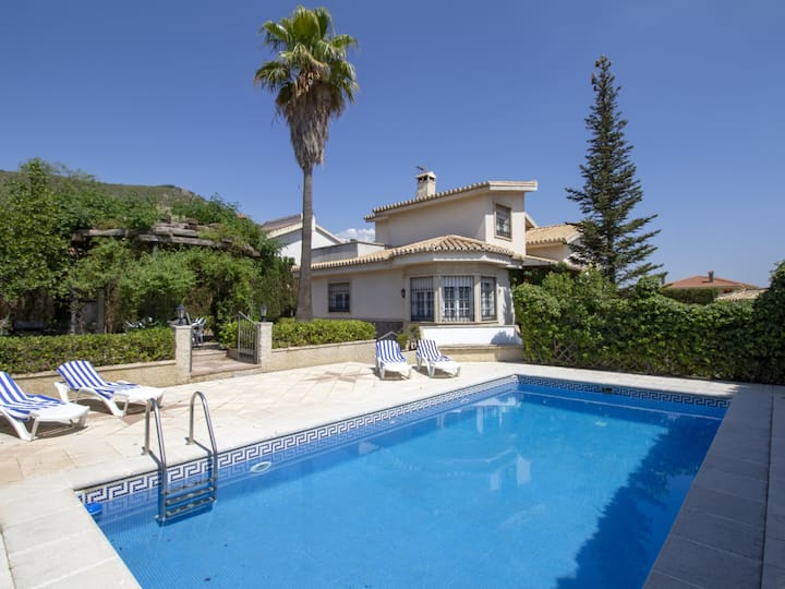 Magnificent villa with garden and pool.