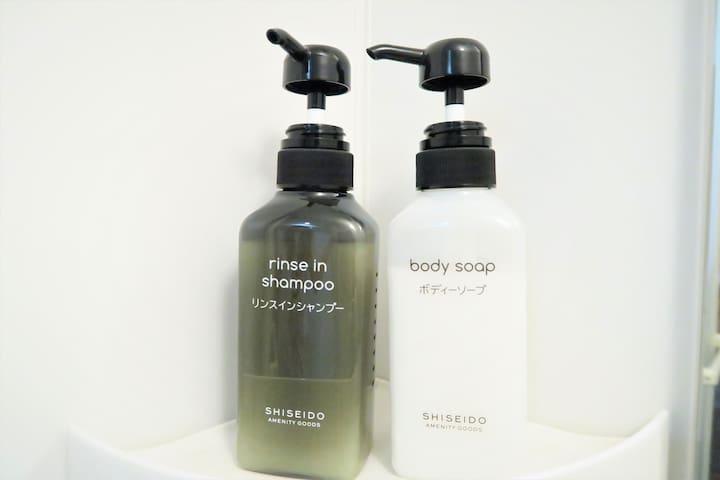 Body soap and shampoo are provided