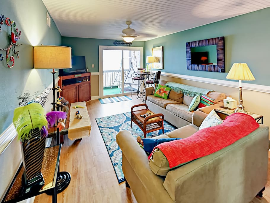 The bright and comfortable living area seats 6. Professionally cleaned and maintained by TurnKey Vacation Rentals.